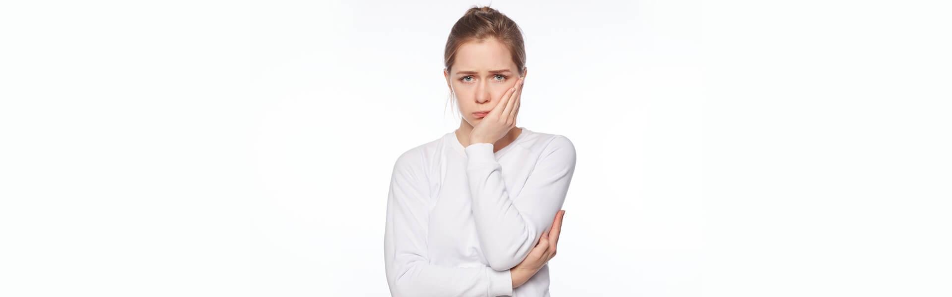Woman having Pain in Teeth